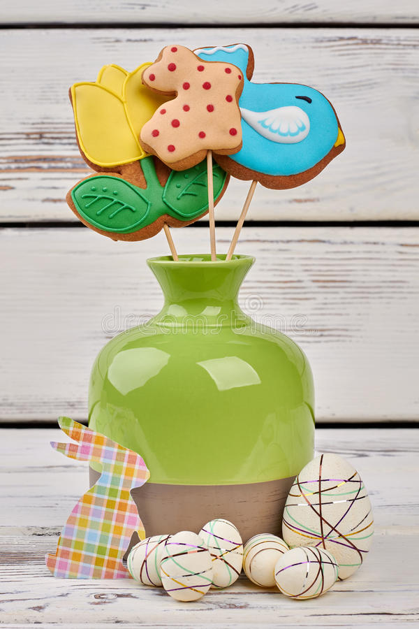 Easter crafts and biscuits. Vase and styrofoam eggs stock photo