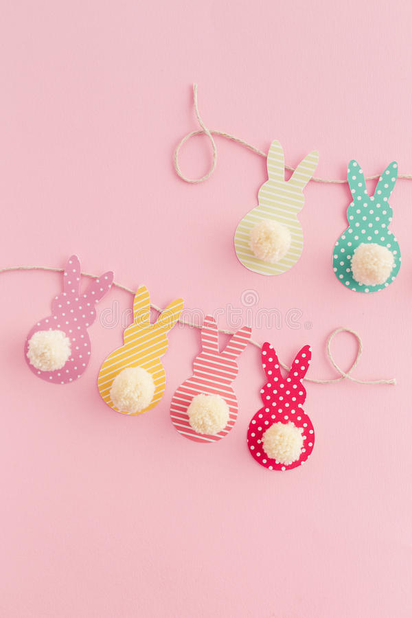 Easter Crafts. Easter Bunny Banner. Cute bunny shapes with yarn pom pom tails stock photos