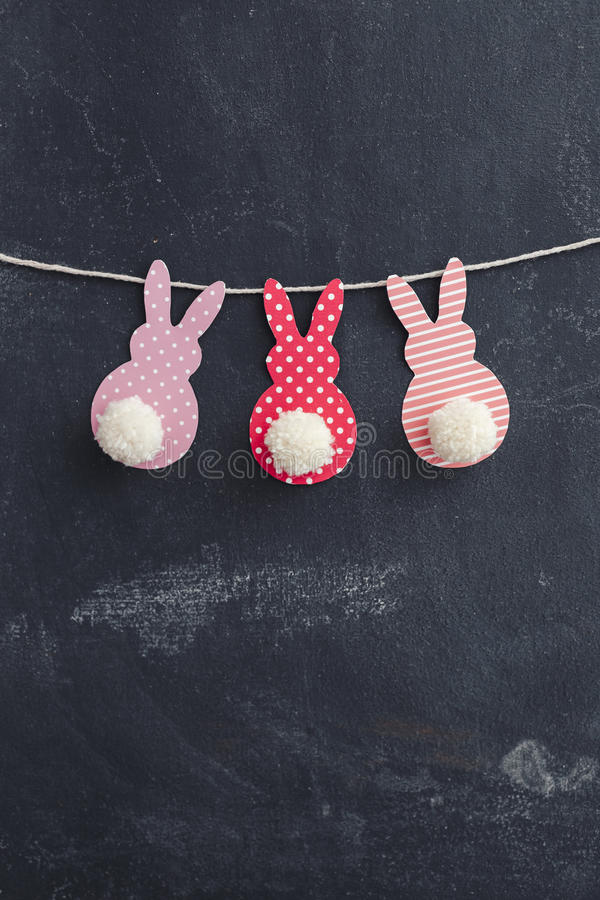Easter Crafts. Easter Bunny Banner. Cute bunny shapes with yarn pom pom tails royalty free stock photography