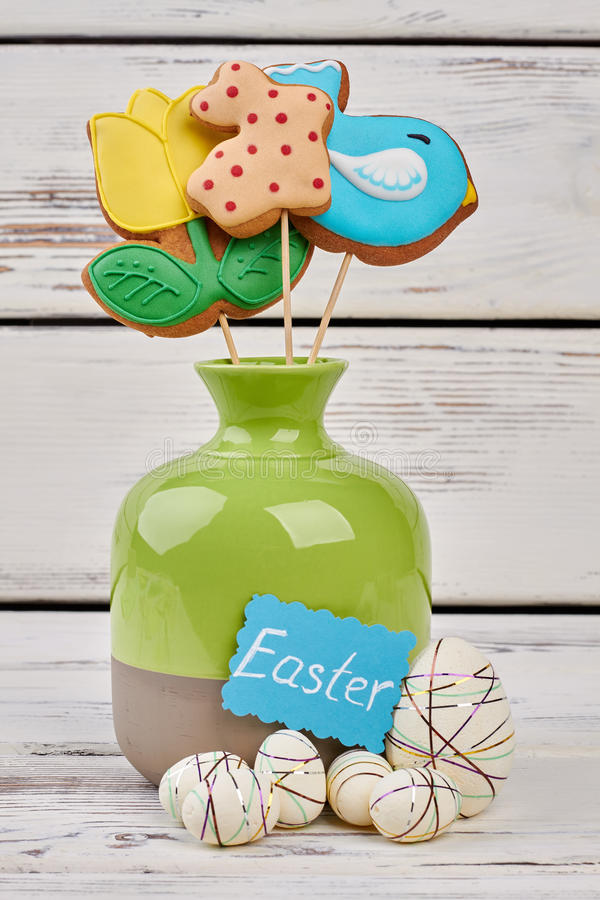 Easter crafts and cookies. Vase and polystyrene eggs stock image