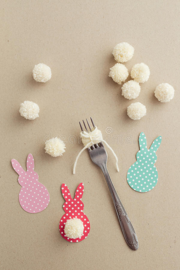 Easter Crafts. Easter craft of making yarn pom pom bunny tail with a fork stock photography