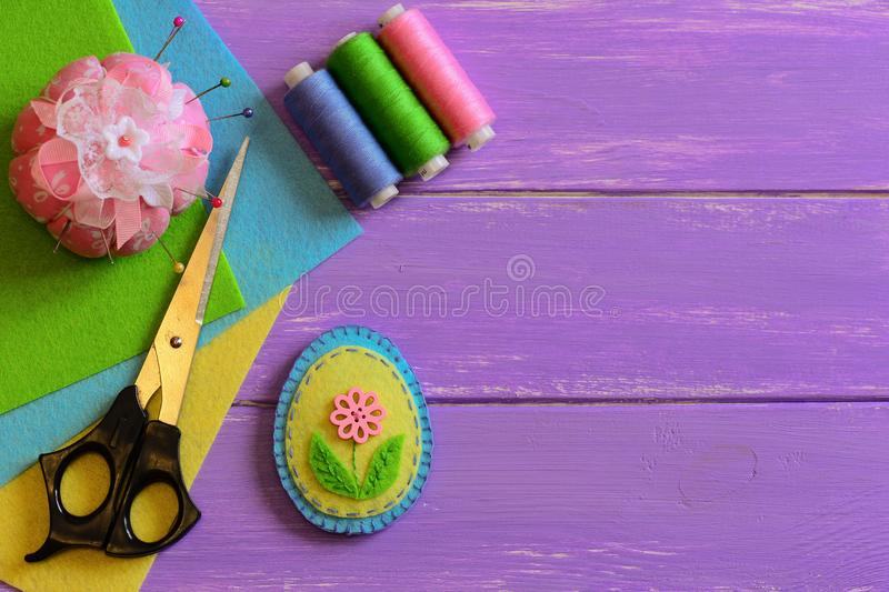 Nice felt Easter egg decoration with flower. Easy Easter crafts for children. Needlework crafts idea. Materials and tools. Easter crafts for kids. Fun DIY idea royalty free stock image