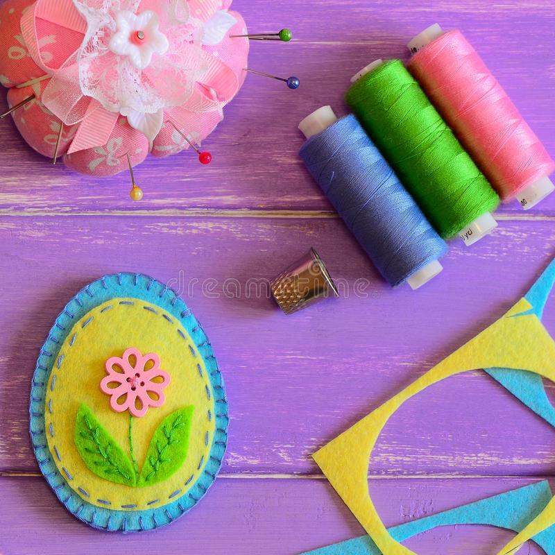 Cute felt Easter egg. Handmade patchwork felt Easter egg, colored thread set, thimble, pin cushion, felt scrap. Easter crafts for kids. Fun DIY idea. DIY for kid royalty free stock photography