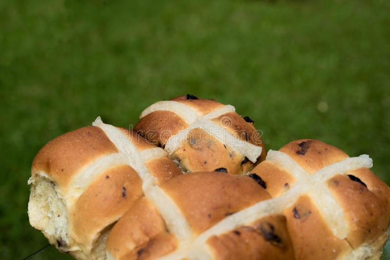 Easter cross buns. On a green grass background royalty free stock photos