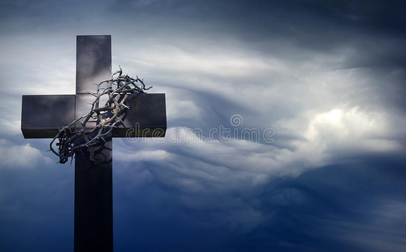 Easter cross with crown of thorns against blue sky abstract background with empty space stock photography