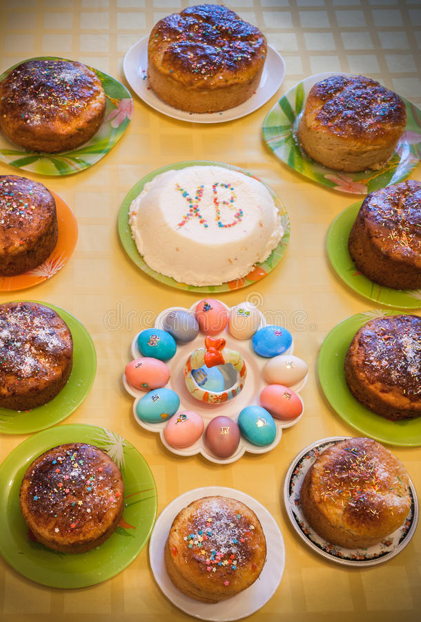 Easter cuisine. Easter cakes, curd Easter and dyed eggs stand on royalty free stock photo