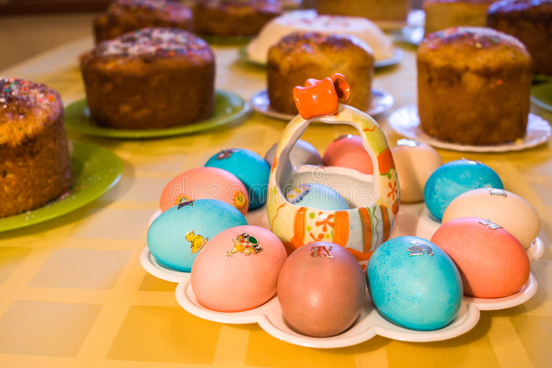 Easter cuisine. In foreground figured plate with colored eggs on royalty free stock photos