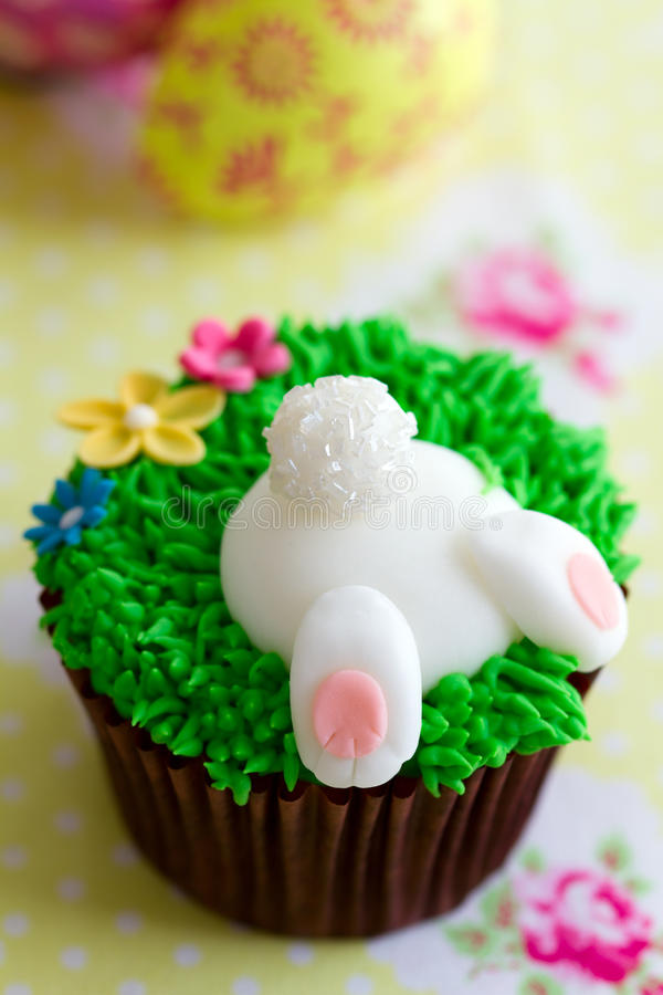 Easter cupcake. Cupcake decorated with a fondant Easter Bunny stock photos