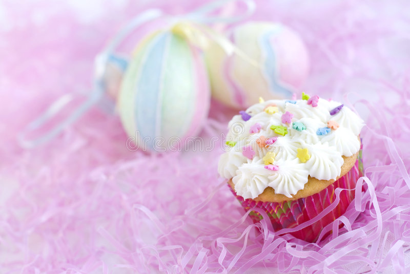 Easter Cupcake with sprinkles and Easter Eggs royalty free stock images