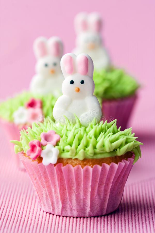 Easter cupcakes. Mini cupcakes decorated with easter bunnies stock photos