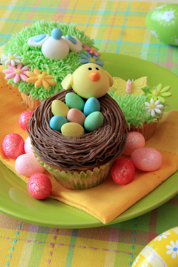 Easter cupcakes. Easter cupcake with Easter eggs and a chick made of fondant stock images
