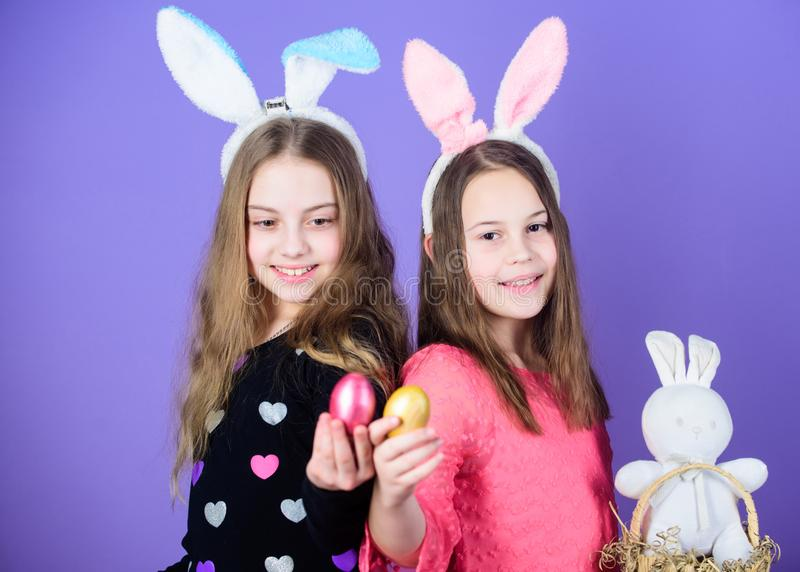 Easter day. Happy easter. Holiday bunny girls with long bunny ears. Egg and bunny holiday attribute. Sisters celebrate. Easter. Spring holiday. Happy childhood royalty free stock photography