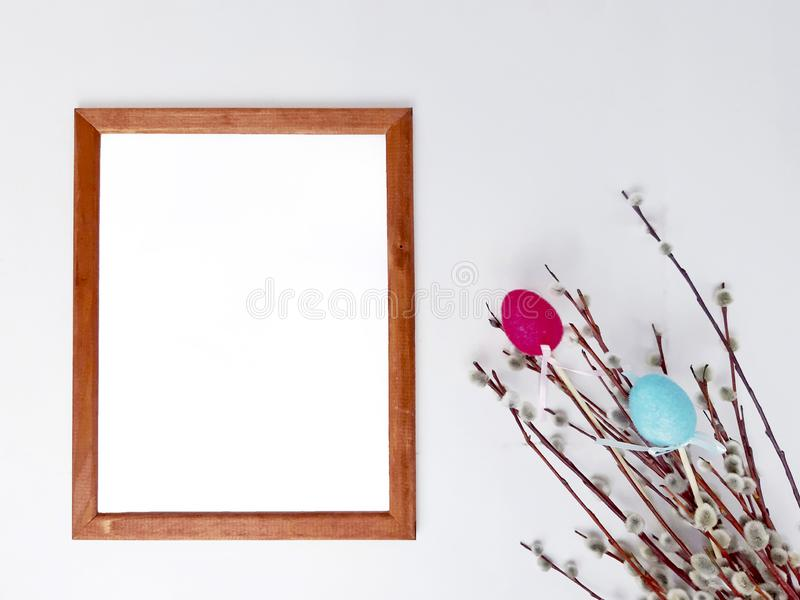 Easter decor with blank frame mockup on white royalty free stock photography