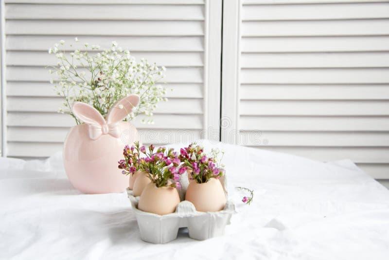 Easter decor - Flowers in eggshells. Easter decor - fresh beautiful Flowers in eggshells stock photography