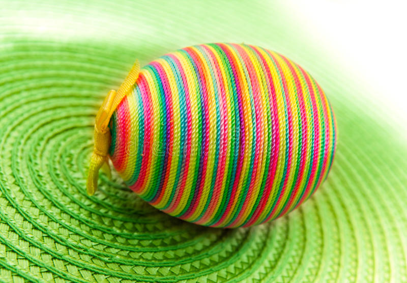 Easter decorastion egg  on green background