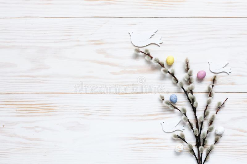 Easter decoration – pattern of colorful decorative eggs and dove figurines on willow branches. Top view, close up, flat royalty free stock photos
