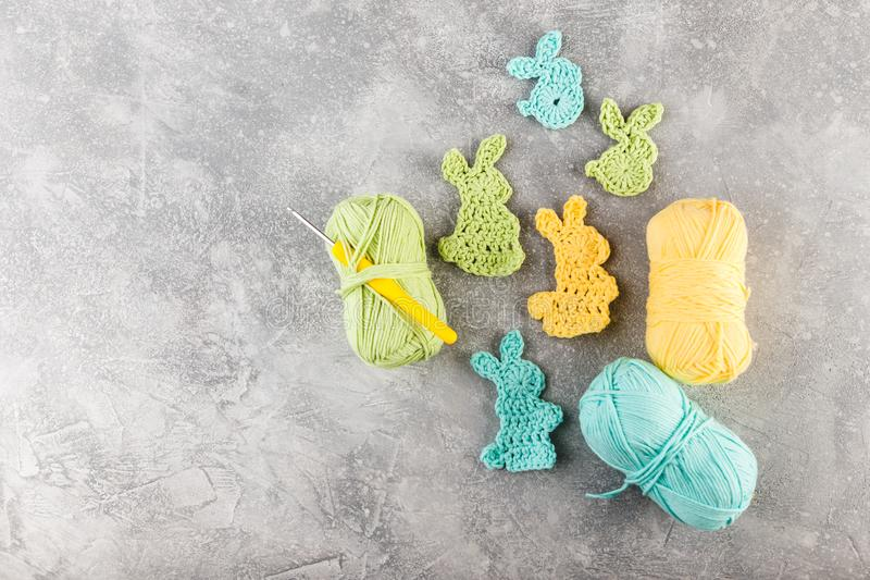 Easter decoration, bunny rabbits made of crochet colorful yarn stock photography