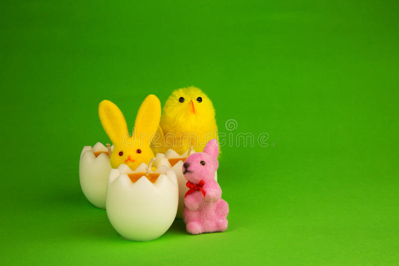 Easter decoration with candle, figurines bunnies and chicken stock photos