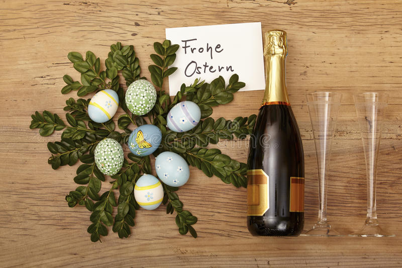Easter decoration, champagner bootle and champagne glasses on wood stock images