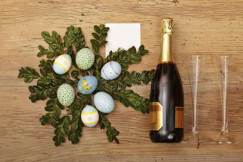Easter decoration, champagner bootle and champagne glasses on wood royalty free stock photo