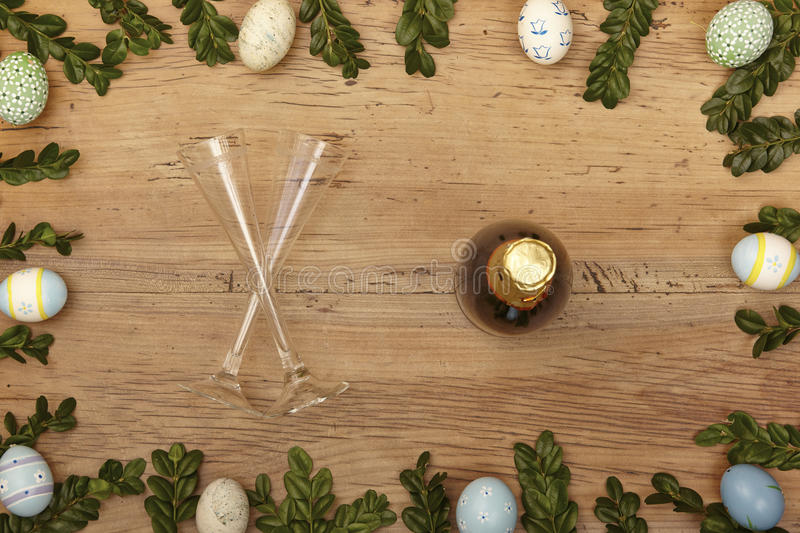 Easter decoration, champagner bootle and champagne glasses on wood royalty free stock image