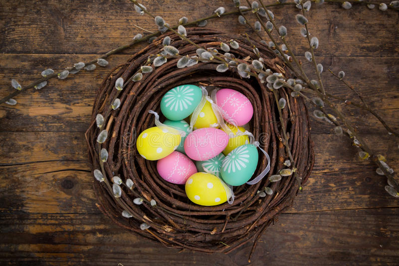 Easter decoration, Easter eggs, twigs on wood royalty free stock image