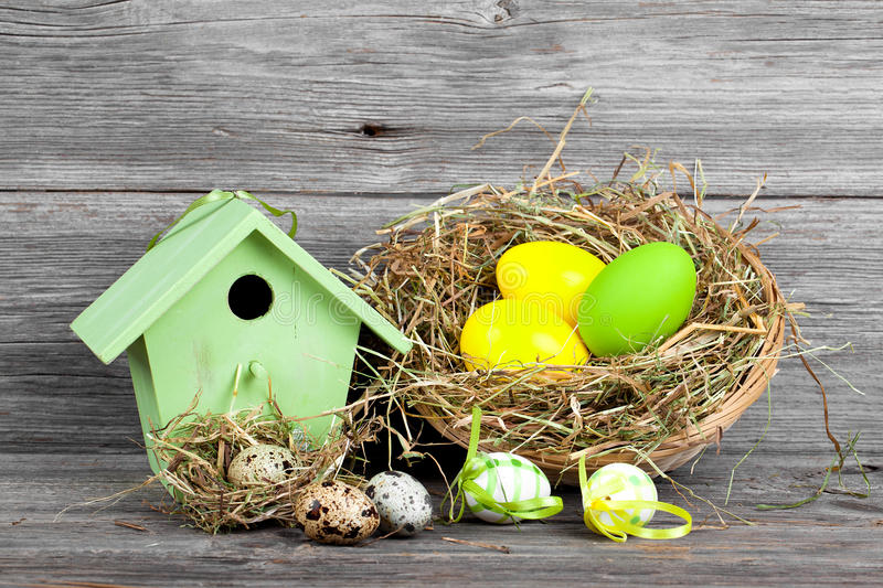 Easter decoration with eggs, birdhouse. stock photography