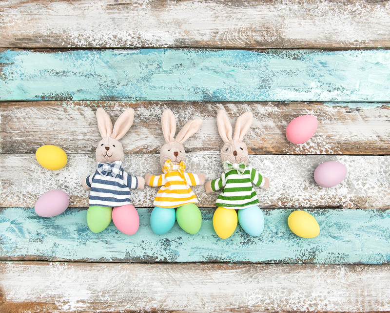Easter decoration eggs funny bunnies wooden background stock photo