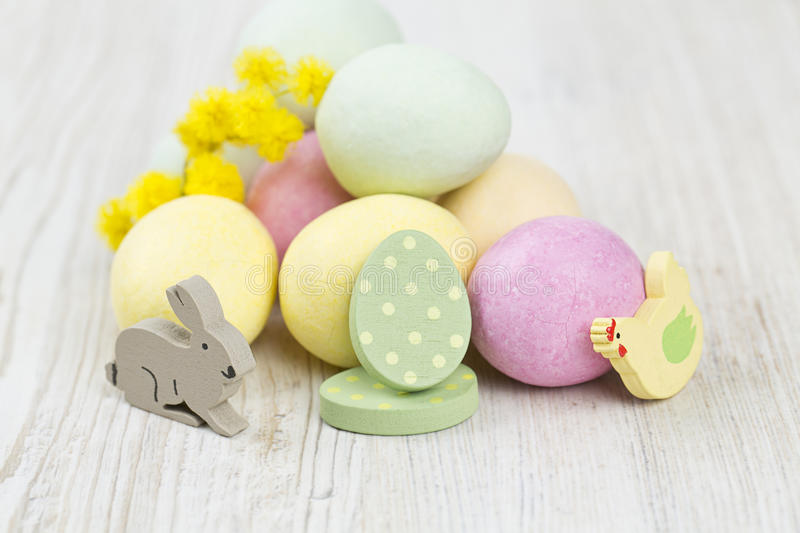 Easter Decoration. Mimosa and marcipan eggs on wooden surface stock images