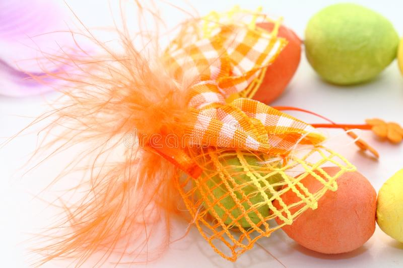 Easter. Decoration - orange ribbon and colorful eggs royalty free stock photography