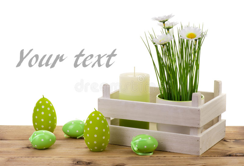 Easter decorations- candle, eggs and flower in pot on the wooden background. stock images