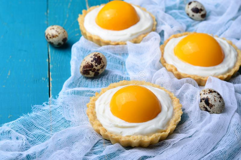Easter Dessert Tartlets. Easter Dessert, Tartlets with Cream and Apricot stock photo