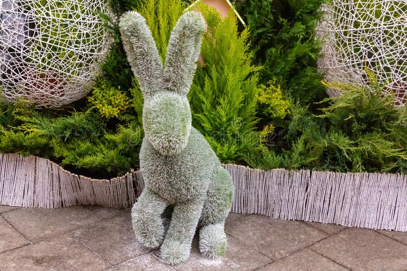 Easter eared rabbit figurine garden fluffy bush decor base copy space royalty free stock images