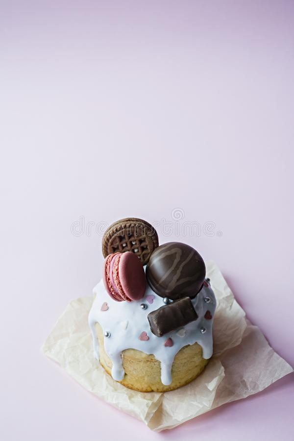 Easter, Easter cake decorated with chocolate and macaroons. Traditional Kulich, Easter Bread. Spring holiday in memory of the royalty free stock image