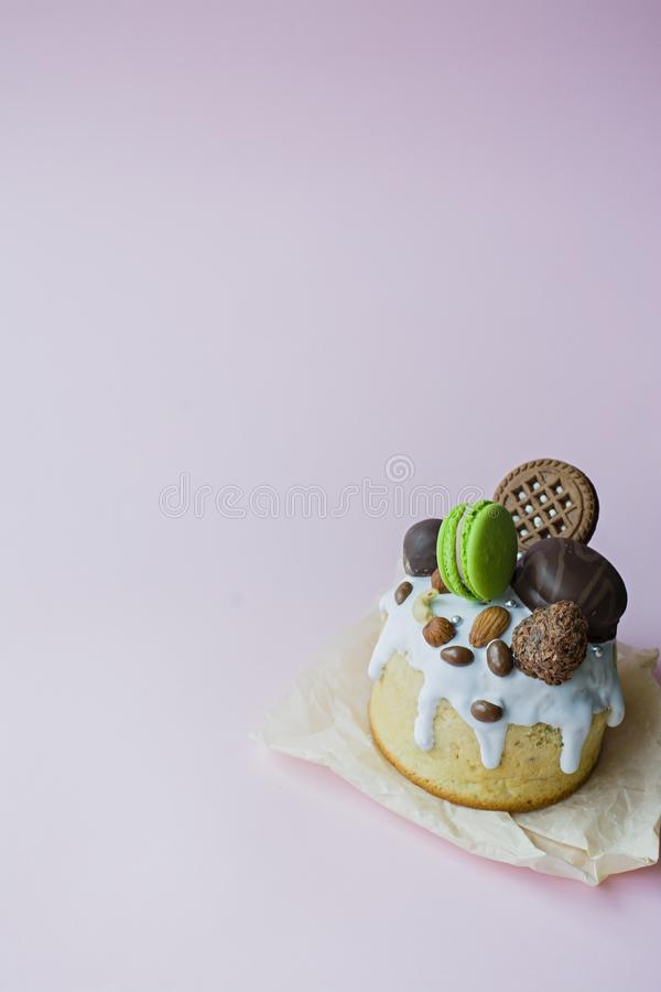 Easter, Easter cake decorated with chocolate and macaroons. Traditional Kulich, Easter Bread. Spring holiday in memory of the stock photos