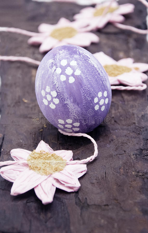 Easter egg. An easter egg on a woden table royalty free stock photo