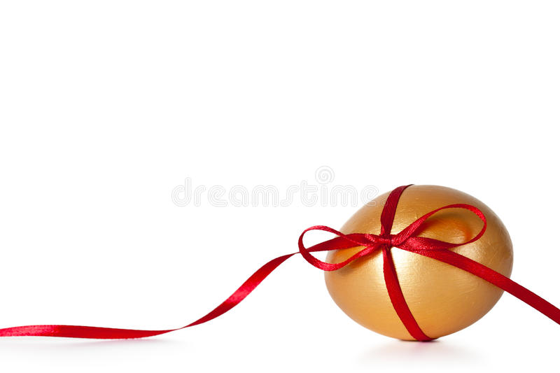 Easter Egg. With red ribbon on white background royalty free stock images