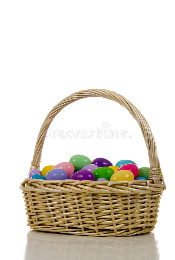 Easter Egg Basket with plastic multicolored Eggs stock photos