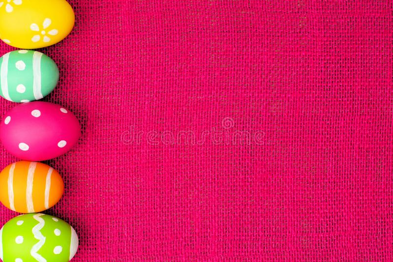 Easter egg border on pink royalty free stock photo