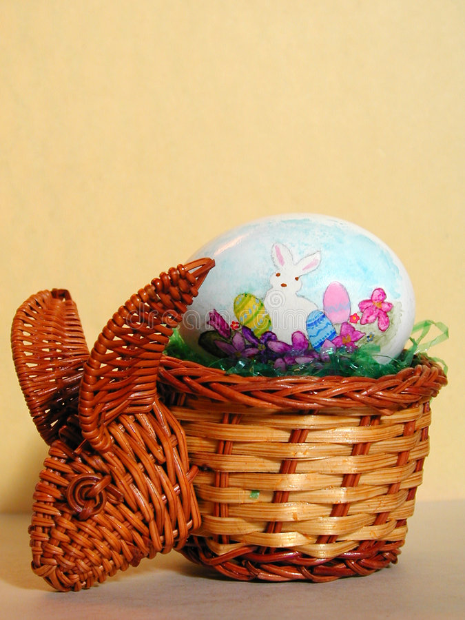 Easter Egg in a Bunny Basket. A hand painted Easter egg in a basket shaped like a rabbit stock photography