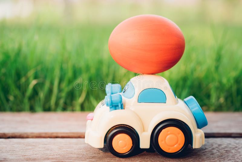 Easter egg and Car on garden grass background stock photography