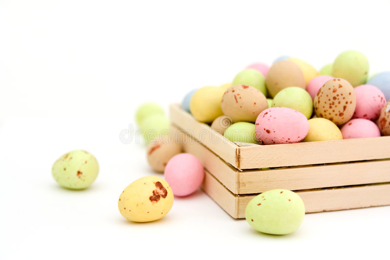 Easter egg chocolate candy. Pastel colour easter egg chocolate candy in wooden box