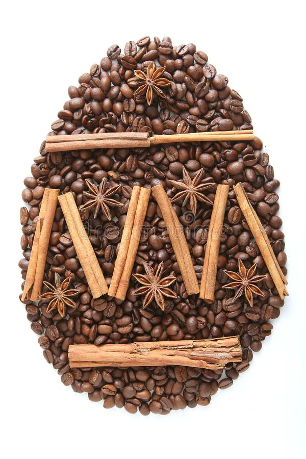 Easter Egg from coffee beans and species isolated on white background. Ccoffee beans grains and ground coffee stock images