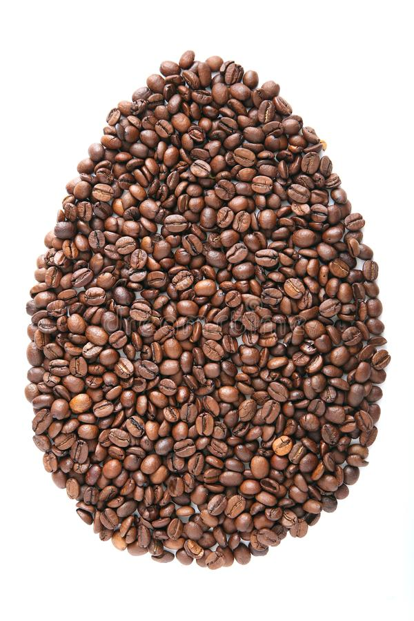 Easter Egg from coffee beans and species isolated on white background. Ccoffee beans grains and ground coffee royalty free stock photography