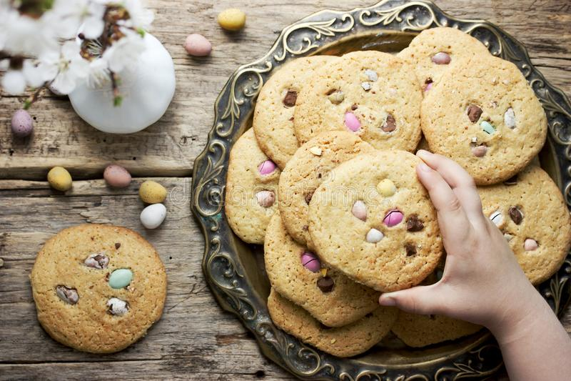 Easter egg cookies for kids. Easter egg cookies - homemade cookies with chocolate candy eggs, traditional Easter treats for kids royalty free stock photo