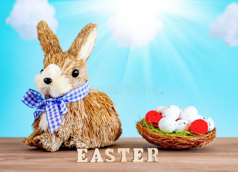 Easter egg and cute bunny on wood table. Festive decoration royalty free stock photo