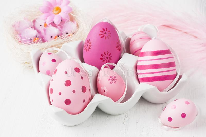 Easter egg decoration in pink color for present stock photography