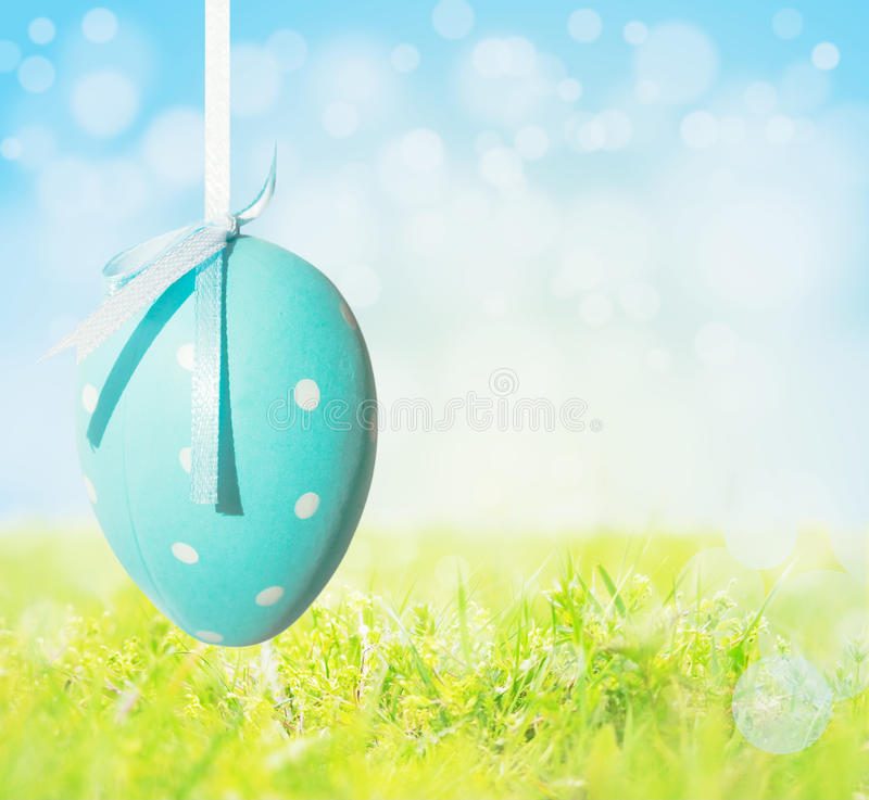Easter egg dots on ribbon,background,spring meadow stock photography