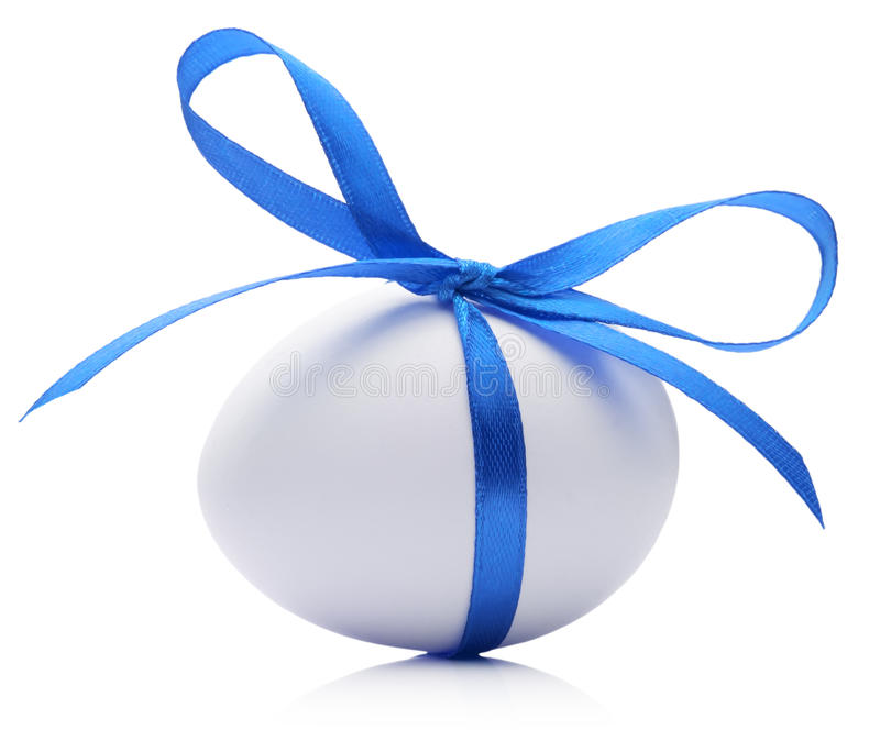 Easter egg with festive blue bow on white background stock image