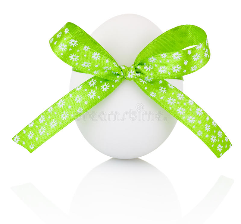 Easter egg with festive green bow isolated on white background stock photos